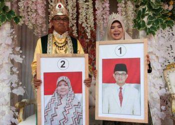 Pilkades di Bogor Digelar Seperti Pesta Pernikahan. (Merdeka.com/Rasyid Ali)